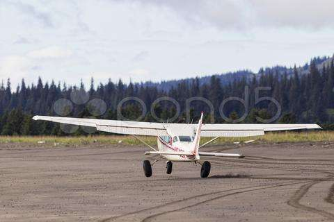Usa, Alaska, Plane Landing On Beach. Click on the image for purchase options on Pond5