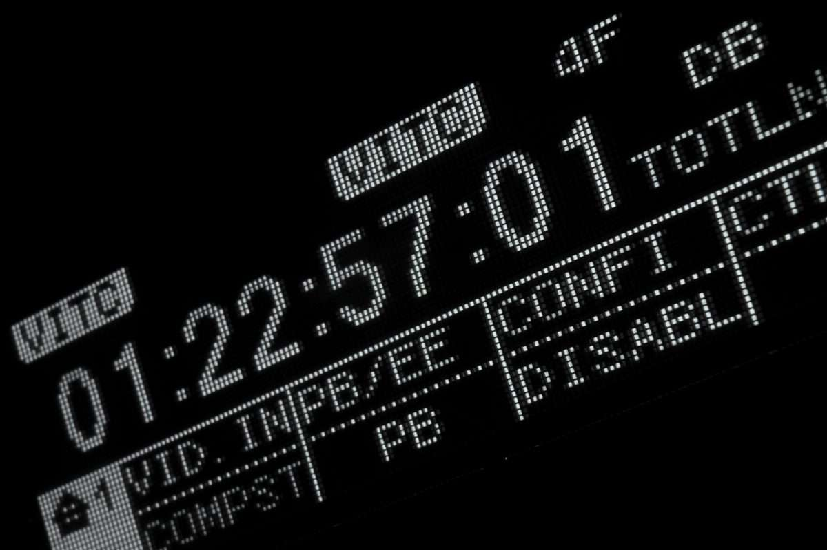 Perspective macro shot of the display of the professional digital betacam video recorder. .Shallow dof. Visible data: timecode, VITC, Video input, composite