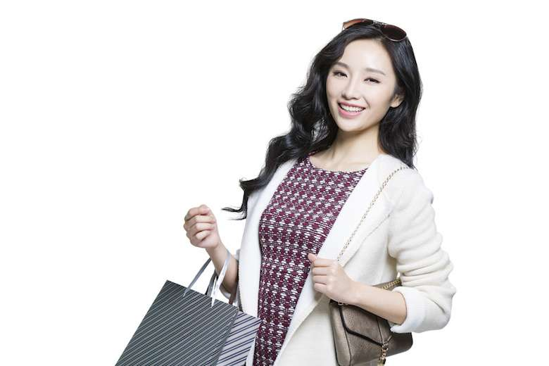 061314020-happy-young-woman-shopping-bag