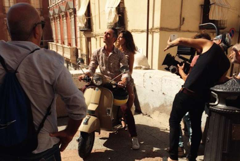 Riding a Vespa in Italy