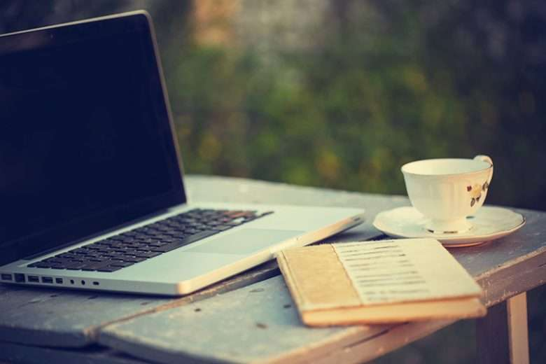 Coffee Cup, Laptop, and Book