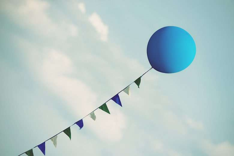 Blue Balloon Floating Against Blue Sky