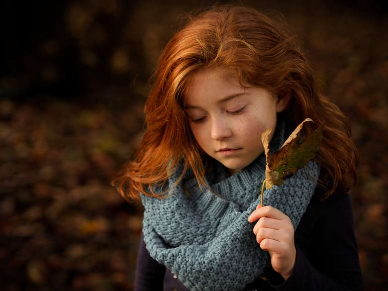 Red Haired Girl Holding Autumn Leaf
