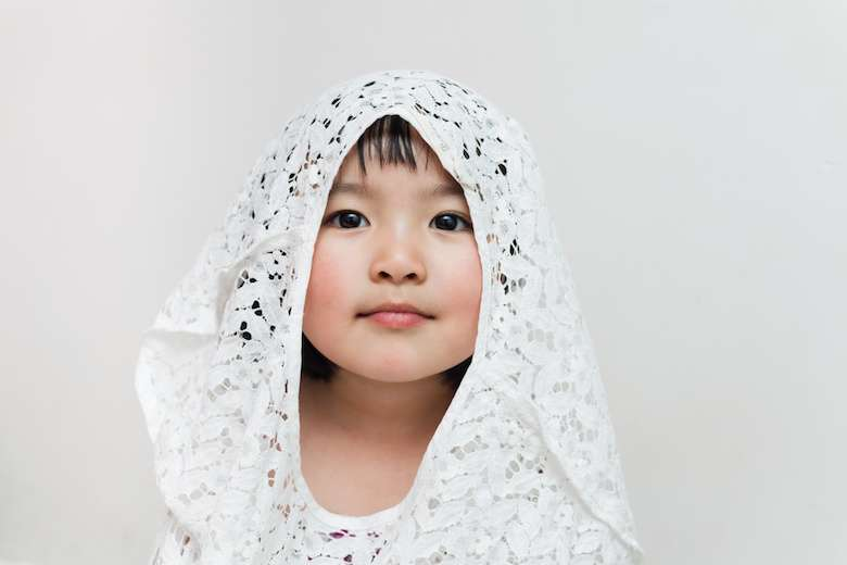 Portrait Of Young Girl In Lace Hood