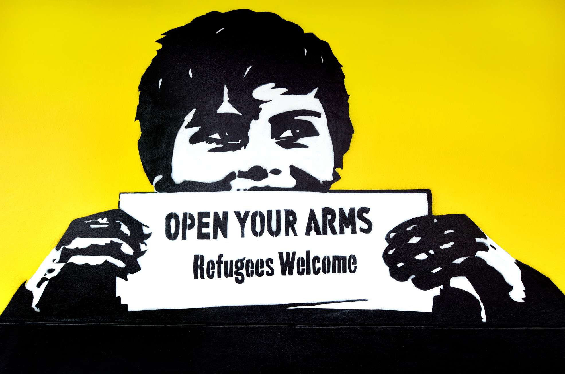 "Graffiti with the political slogan ""Refugees Welcome"""