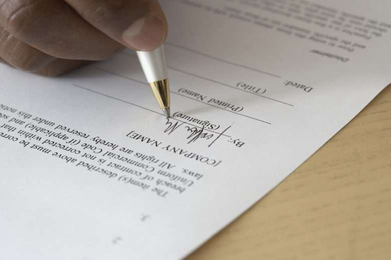 close up of hand filling out form
