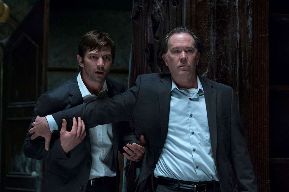 Michiel Huisman and Timothy Hutton in 'The Haunting of Hill House'
